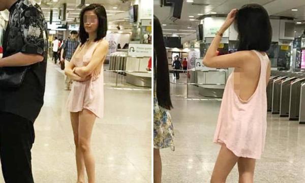 Mặc lớp áo mỏng hờ hững không nội y đi rút tiền, cô gái gây bão mạng xã hội-1