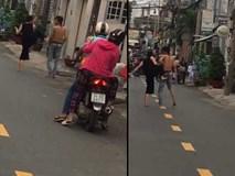 Clip kinh sợ nhất đêm qua: Cô gái ngáo đá vác dao ra phố chém gục một gã đồng nghiện