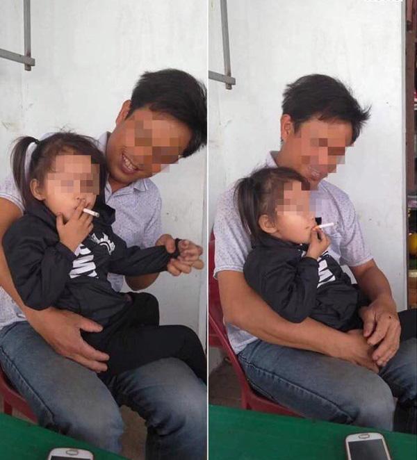 Bé gái vui vẻ hút thuốc lá, thái độ kì lạ của ông bố ngồi bên cạnh gây bức xúc-1