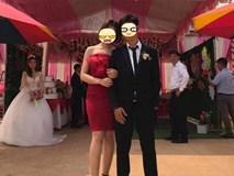 Chiếc ảnh cô nàng váy đỏ ôm tay tựa đầu vào chú rể giữa rạp cưới rất xinh cho đến khi dân tình phát hiện ra cô dâu phía sau