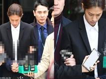 Jung Joon Young bị trói, còng tay áp giải đến phòng giam tại đồn cảnh sát