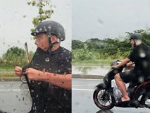 Người đàn ông bắt vợ đi taxi rồi đội mưa chạy xe theo gây thích thú, danh tính của anh mới bất ngờ