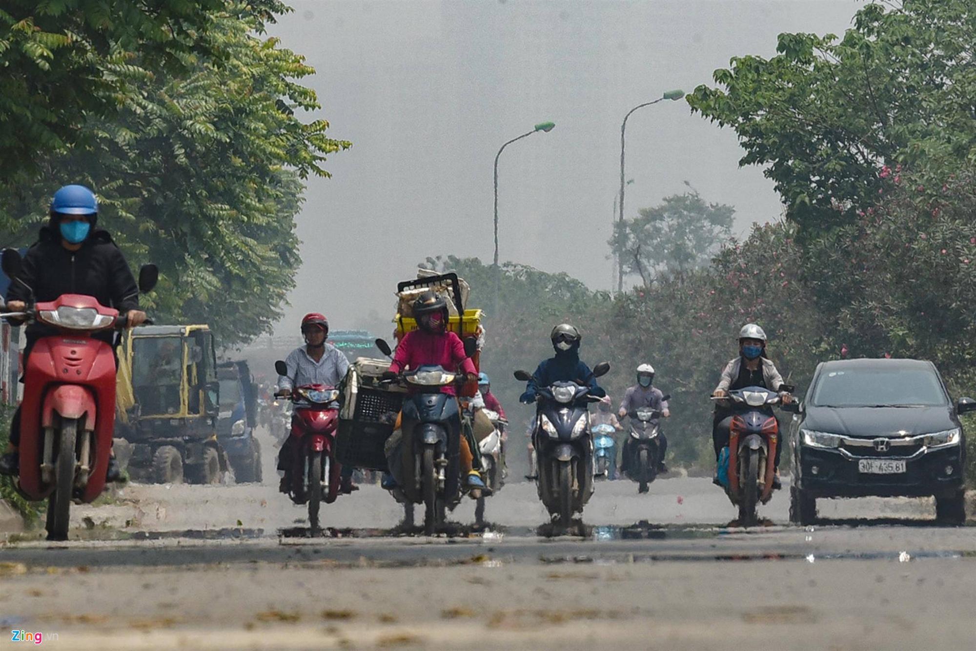 Mặt đường ở Hà Nội nóng hơn 50 độ C-3