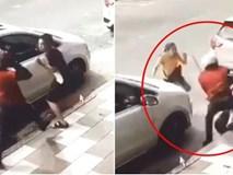 Vợ dũng cảm lao ra bảo vệ chồng khỏi kẻ biến thái tấn công bằng dao rựa giữa đường