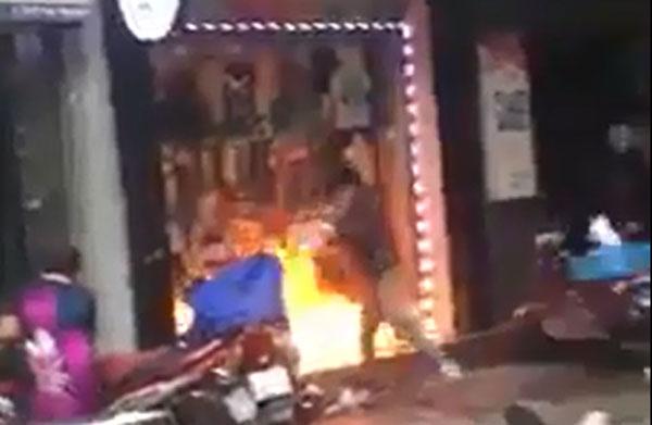 Danh tính người đàn ông ngang nhiên châm lửa đốt cửa hàng của vợ cũ trên phố Hải Phòng-1