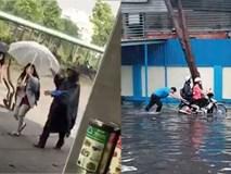 Clip bác bảo vệ che ô, lội nước đẩy xe cho sinh viên giữa trời mưa gió khiến dân mạng tan chảy vì quá đáng yêu