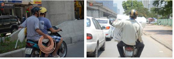 Nắng nóng đỉnh điểm ở Hà Nội, thợ điều hòa kiếm tiền triệu mỗi ngày-2