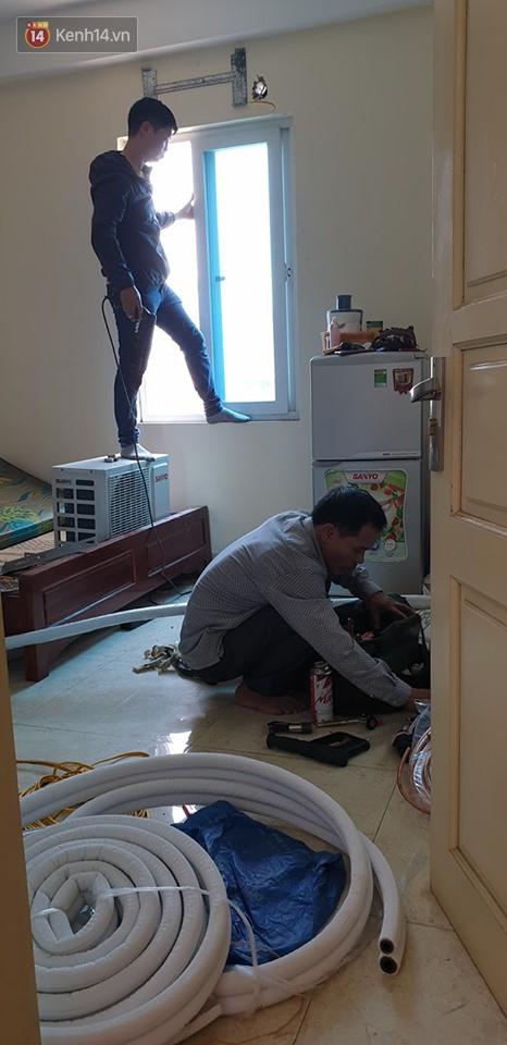 Nắng nóng đỉnh điểm ở Hà Nội, thợ điều hòa kiếm tiền triệu mỗi ngày-3