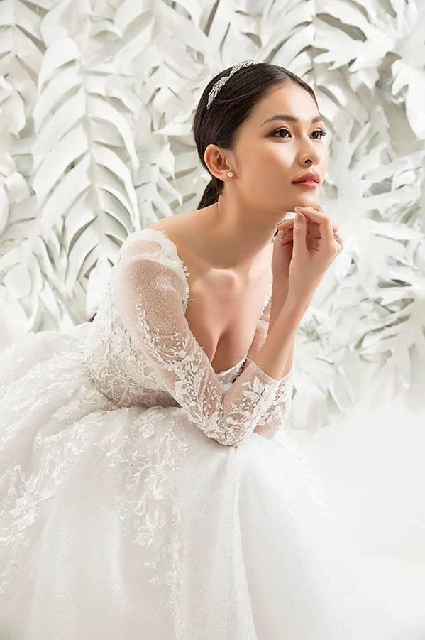 Sau khi công khai bạn trai, Á hậu Thuỳ Dung gợi cảm với váy cưới xuyên thấu-3