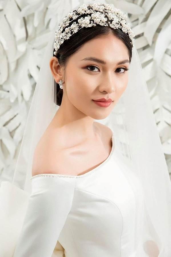 Sau khi công khai bạn trai, Á hậu Thuỳ Dung gợi cảm với váy cưới xuyên thấu-11