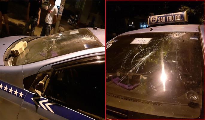 Cho rằng bị chặt chém, nhóm người nước ngoài hành hung tài xế, đập phá taxi ở Hà Nội-1