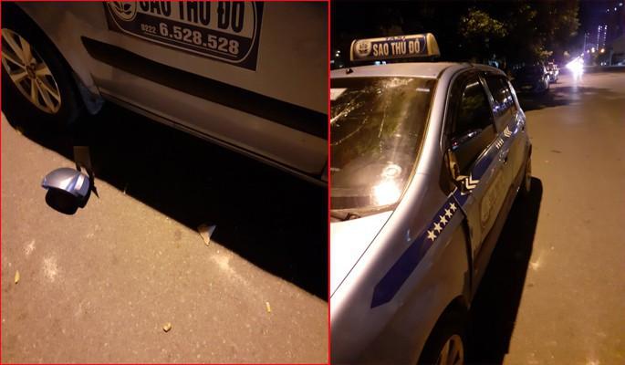 Cho rằng bị chặt chém, nhóm người nước ngoài hành hung tài xế, đập phá taxi ở Hà Nội-2