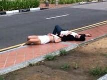 Say rượu, cặp vợ chồng nằm ngủ giữa đường nhưng khi được gọi dậy còn phản ứng bất ngờ hơn