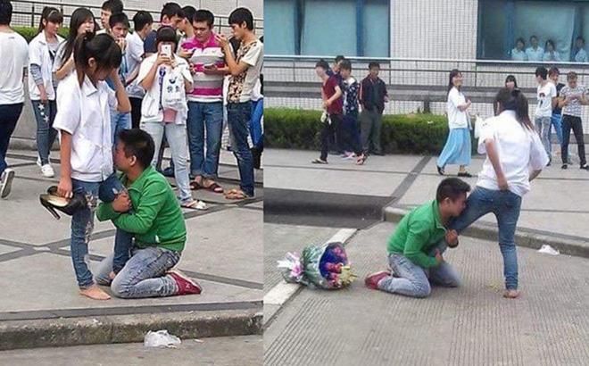 Chàng trai quỳ gối, ôm chân cô gái không chịu rời, bó hoa bị vứt sang một bên-1