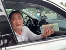 Vụ người xưng chủ xe Mercedes giơ xấp tiền