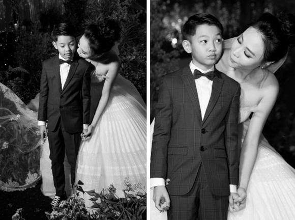 Hình ảnh đẹp nhất trong đám cưới Cường Đô La: Đàm Thu Trang diện váy cô dâu hôn má con trai riêng của chồng - bé Subeo cực đáng yêu-4