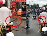 Người đàn ông và thứ 'vũ khí nguy hiểm' ung dung di chuyển trên phố khiến tất cả giật mình