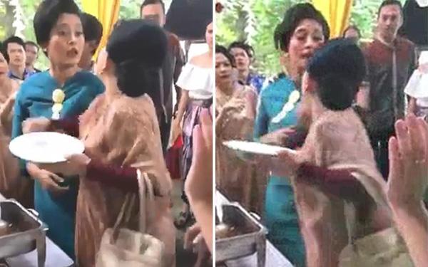 Ăn mặc sang trọng đi ăn cưới, 2 người phụ nữ cãi nhau ỏm tỏi chỉ vì tị nạnh ai gắp nhiều miếng hơn-1