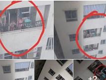Hình ảnh 2 em bé leo lên ban công tầng 25, đu lưới