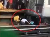 Bé gái 5 tuổi thoát chết khi bị bố lôi vào gầm tàu để tự tử