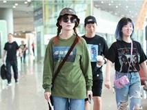 Hậu tin đồn ly hôn, Triệu Vy đội mũ xanh lá xuất hiện tại sân bay, ám chí bị