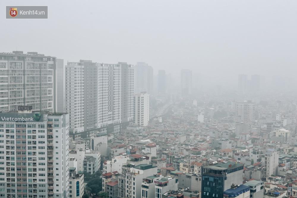 Chùm ảnh: Một ngày sau cơn mưa vàng, đường phố Hà Nội lại chìm trong bụi mù-2
