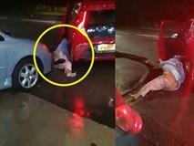 Cảnh tượng gây sốc khi người phụ nữ bị nam tài xế xe ô tô kéo lê trên đường trong cuộc tấn công tàn bạo
