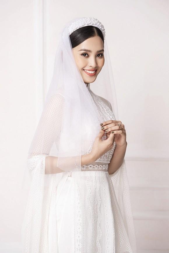 Hoa hậu Tiểu Vy diện áo dài trắng tinh khôi e ấp như 'đoá hoa chớm xuân'-5