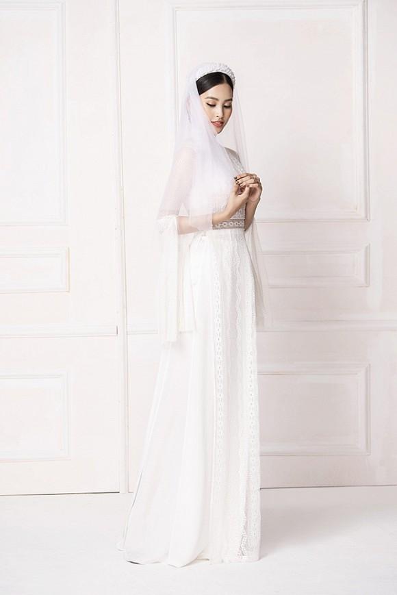 Hoa hậu Tiểu Vy diện áo dài trắng tinh khôi e ấp như 'đoá hoa chớm xuân'-6