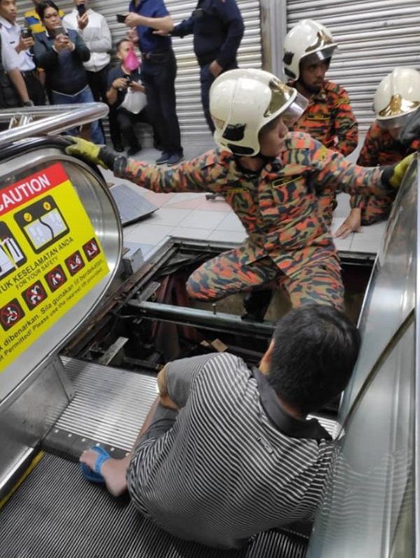 Mang dép lê đi siêu thị, người đàn ông 49 tuổi bị thang cuốn nuốt chửng chân phải-4