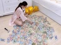 """Đập heo được gần 3 tỷ, hotgirl Sài Thành bị """"tố"""" làm trò câu view vì chi tiết bất thường"""