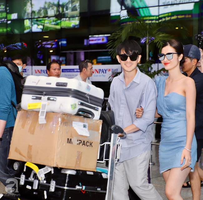 Đông Nhi - Ông Cao Thắng cực thời thượng xuất hiện tại sân bay về TP.HCM, tay trong tay không rời 1 giây-2