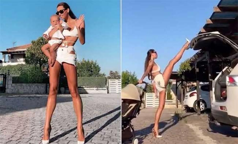 Người phụ nữ Nga có cặp giò dài gần nhất thế gian, lấy chân đóng cốp xe điệu nghệ-7