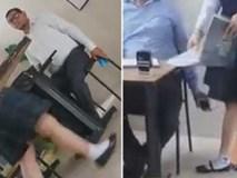 Phẫn nộ khoảnh khắc thầy giáo cầm sẵn điện thoại để chụp lén dưới váy nữ sinh khi kiểm tra bài tập