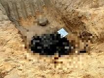 Kinh hoàng phát hiện thi thể cháy đen nằm dưới hố sâu giữa ban ngày
