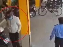 Tên trộm định cuỗm xe máy ngay trước mặt bảo vệ cửa hàng