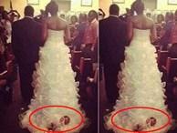 Bức ảnh chụp đám cưới gây xôn xao bởi mọi sự chú ý dồn vào đứa trẻ 1 tháng tuổi bị buộc vào chân váy của cô dâu