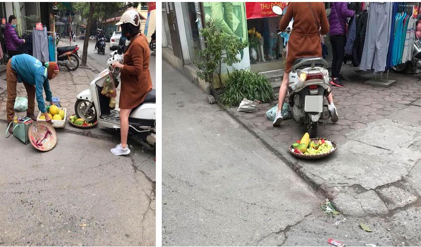 Bức xúc người phụ nữ cán nát mẹt hoa quả của cô bán hàng rong vì ngồi chắn cửa-2