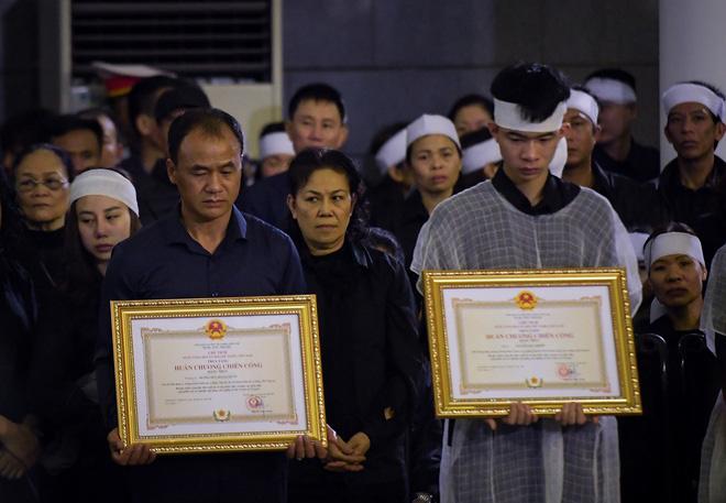 Hà Nội đề xuất trợ cấp cho con của 2 cảnh sát hy sinh ở Đồng Tâm-1