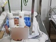 Bé trai 4 tháng tuổi nghi bị bố đánh đến xuất huyết não, gãy chân