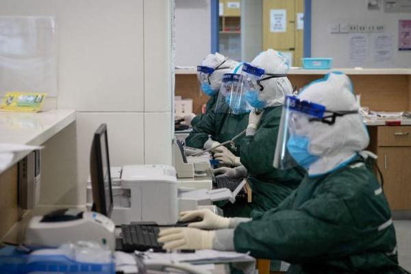 Tín hiệu tích cực: Số ca tử vong trong ngày của TQ thấp nhất trong 2 tuần, WHO nói đã qua đỉnh dịch-1