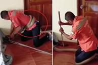 Rắn hổ mang chúa quấn chặt bụng thợ bắt rắn khi bị phát hiện