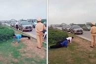 Clip: CSGT phạt tài xế chống đẩy giữa đường vì không đeo khẩu trang phòng chống dịch bệnh