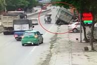 Tránh xe ba gác, xe tải mất lái mắc kẹt vào cống thoát nước
