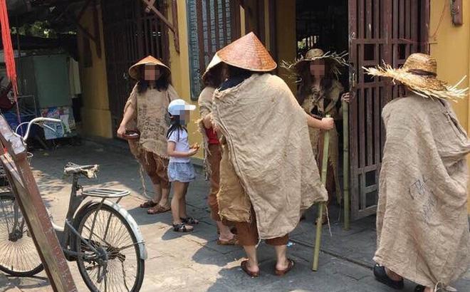 Xác minh nhóm người ăn mặc lạ, đội nón lá, mang gậy, bát vỡ, quay phim, phát trực tiếp trên facebook-1