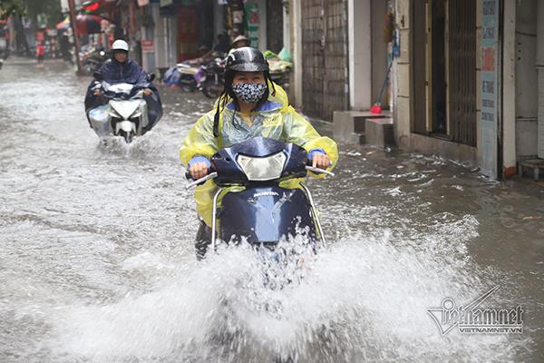 Dự báo thời tiết hôm nay: Hà Nội mưa to, phòng ngập lụt-1