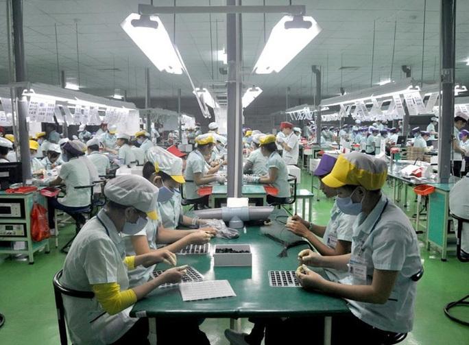 Doanh nghiệp cho người lao động nghỉ việc trái luật phải bồi thường-1