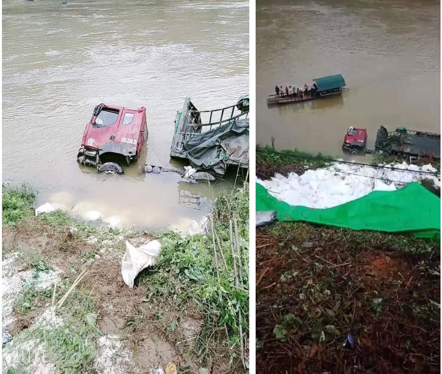 Xe chở gạo lật nghiêng rơi xuống sông, hình ảnh tài xế thất thần ngồi co ro trên bờ gây chú ý-1