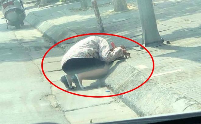 Trưa hè nóng nực, người phụ nữ gục bên lề đường, lý do đằng sau khiến người khác phải bật cười-1