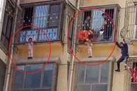 Lính cứu hỏa và cảnh sát cứu trẻ bị treo lơ lửng ở tầng 3